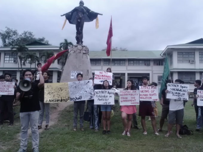 A student-leader leads the protests as others hold placards in condemnation of the President's actions in relation to the death of 44 PNP Special Action Force men, in a rally Friday afternoon. Photo: Charity Rulloda.